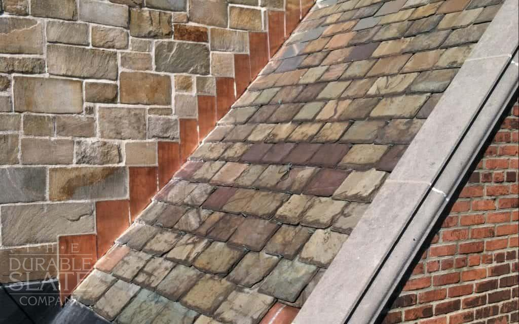 steep slate roof with copper flashings running alongside the edge