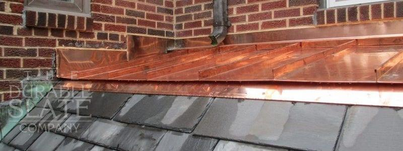 slate roof with copper flashings