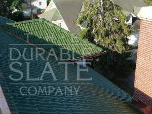 green clay tile roof in st paris ohio with evergreens in the background