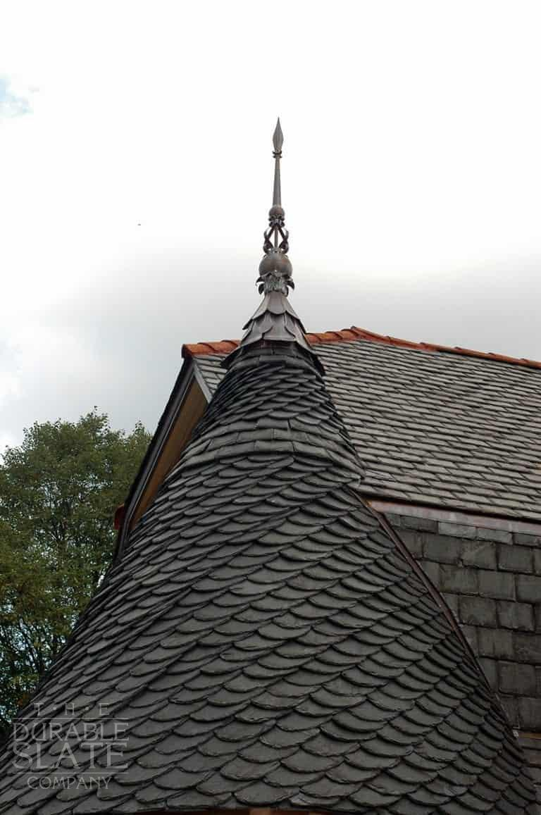Turret is a sprawling ranch house that we changed into an old looking mansion. We used salvaged Peach Bottom slate from Pennsylvania to give it a look like it's always been there. We installed the turret in a German installation method.