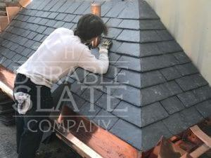 slate apprentice training on a durable slate mock-up roof