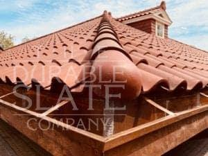 a close shot of spanish red roofing tiles in from a repaired home in south carolina