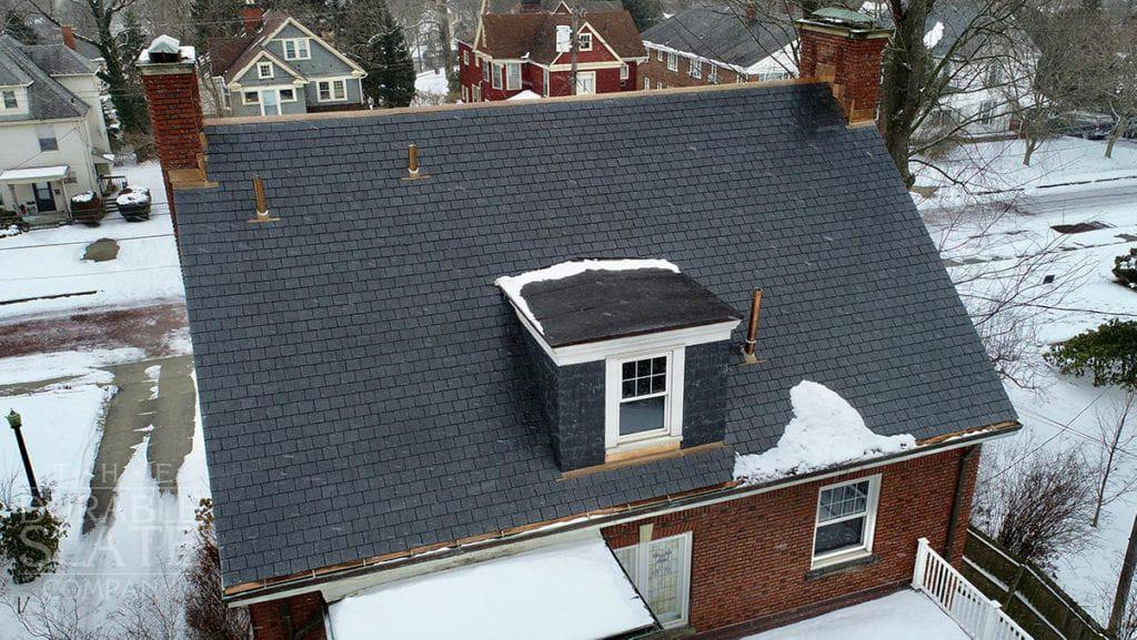 slate roof with copper work and fresh snow in akron ohio