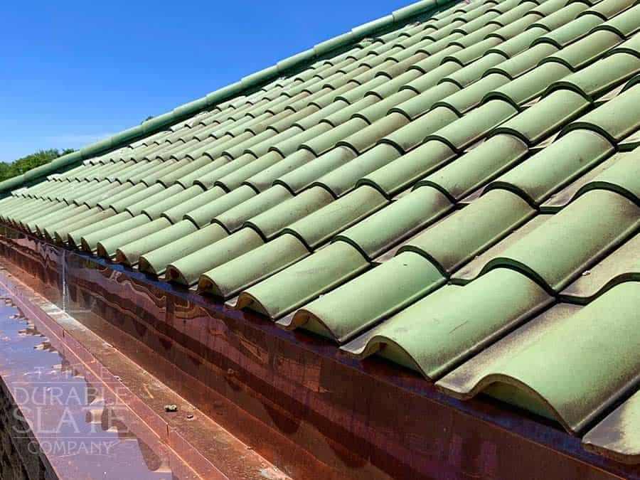 green clay tile roofing with copper gutters